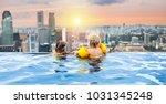 children swimming in roof top... | Shutterstock . vector #1031345248