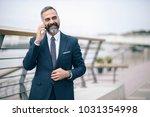 casual senior business man... | Shutterstock . vector #1031354998
