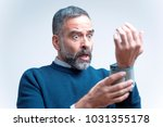senior man shocked and outraged ... | Shutterstock . vector #1031355178