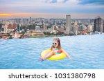 children swimming in roof top...   Shutterstock . vector #1031380798
