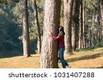 Young Girl Hug A Big Tree In...