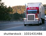 bright red classic big rig semi ... | Shutterstock . vector #1031431486