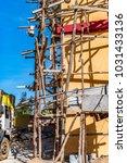 blue gum poles lashed together...   Shutterstock . vector #1031433136