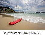 red surfboard laying on...   Shutterstock . vector #1031436196