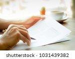 business man hand holding pen... | Shutterstock . vector #1031439382