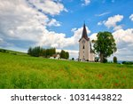 lonely church in the poppy... | Shutterstock . vector #1031443822