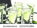 tropical cocktail with lime and ... | Shutterstock . vector #1031451886