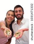 beautiful couple saving money...   Shutterstock . vector #1031471332