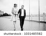 young couple in love walking... | Shutterstock . vector #1031485582