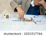 boy hand putting money coin...   Shutterstock . vector #1031517766