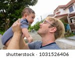 portrait of father and baby son ... | Shutterstock . vector #1031526406