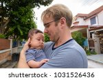 portrait of father and baby son ... | Shutterstock . vector #1031526436