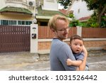 portrait of father and baby son ... | Shutterstock . vector #1031526442