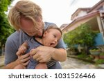 portrait of father and baby son ... | Shutterstock . vector #1031526466