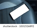 mobile phone on car seat....   Shutterstock . vector #1031526892