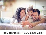 let take a photo of our happy... | Shutterstock . vector #1031536255