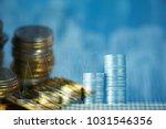 double exposure of coin stacks... | Shutterstock . vector #1031546356