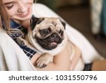 young woman with cute pug dog... | Shutterstock . vector #1031550796