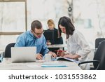 colleagues working on a project ... | Shutterstock . vector #1031553862