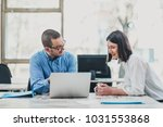 two colleagues monitoring...   Shutterstock . vector #1031553868