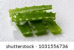 sliced leaves of aloe vera on a ... | Shutterstock . vector #1031556736