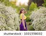 outdoor spring portrait of a... | Shutterstock . vector #1031558032