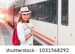 traveler girl waiting and ... | Shutterstock . vector #1031568292
