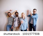 group of young handsome... | Shutterstock . vector #1031577508