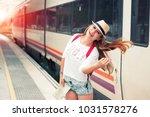 traveler girl waits train on... | Shutterstock . vector #1031578276