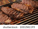 beef steaks on the grill with... | Shutterstock . vector #1031581195