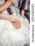 newly wed couple's hands with... | Shutterstock . vector #1031582092
