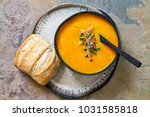 carrot soup with the topping of ... | Shutterstock . vector #1031585818