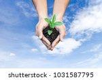 ecology concept human hands... | Shutterstock . vector #1031587795