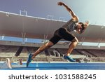 athlete starting his sprint on... | Shutterstock . vector #1031588245
