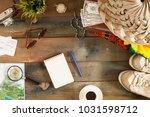 travel planning on table | Shutterstock . vector #1031598712