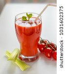 tomato juice in a glass with... | Shutterstock . vector #1031602375