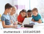 cute children doing homework in ... | Shutterstock . vector #1031605285