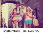 young parents with two kids... | Shutterstock . vector #1031609722