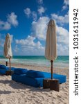 luxury blue beach chairs on the ... | Shutterstock . vector #1031611942