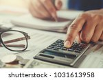 accountant using calculator to... | Shutterstock . vector #1031613958