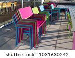 colorful piled up chairs on an... | Shutterstock . vector #1031630242