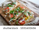 toasts with egg  aragula ... | Shutterstock . vector #1031632636