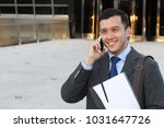 Small photo of Sophisticated ethnic male calling by phone isolated with copy space