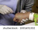 hand of nurse put intravenous...   Shutterstock . vector #1031651332