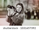 young cheerful woman looking... | Shutterstock . vector #1031657392