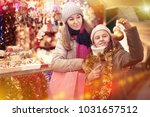smiling girl with woman are... | Shutterstock . vector #1031657512
