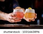 bartender is serving short sour ...   Shutterstock . vector #1031663896