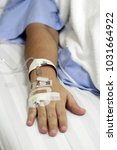 iv solution in a patients hand   Shutterstock . vector #1031664922