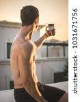 rear view of young muscular man ... | Shutterstock . vector #1031671756