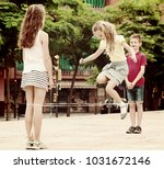 happy boy and girls in... | Shutterstock . vector #1031672146